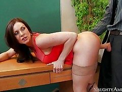 Lengthy haired brunette Kendra Passion with magnificent big melons is